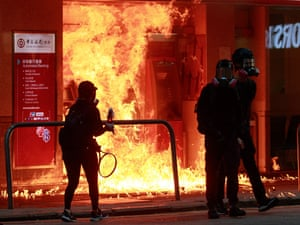 Protesters burn Bank of China's ATM with a petrol bomb