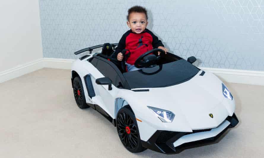 One-year-old Thiago Greer in his toy Lamborghini