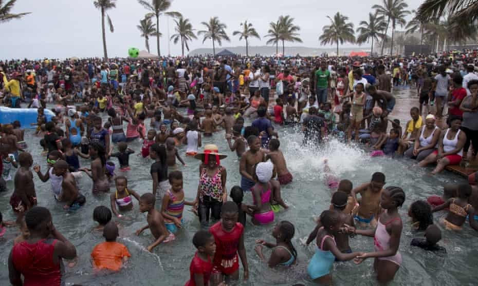 New Year's Day in Durban … the beach is crowded with people who a generation ago were not allowed on the sand
