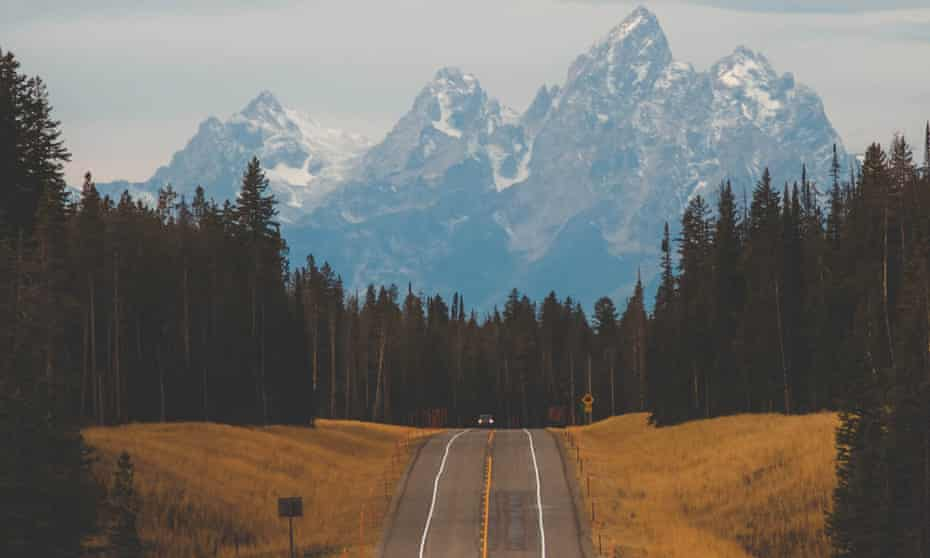 The road to Jackson Hole, Wyoming resort with mountains in the distance