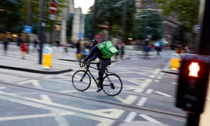 A cyclist delivering food in Manchester