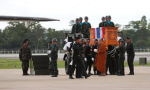 A Thai Buddhist monk leads military guards