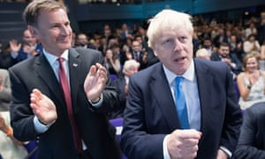 Jeremy Hunt (left) and Boris Johnson react after Johnson is announced winner of the Conservative leadership race.