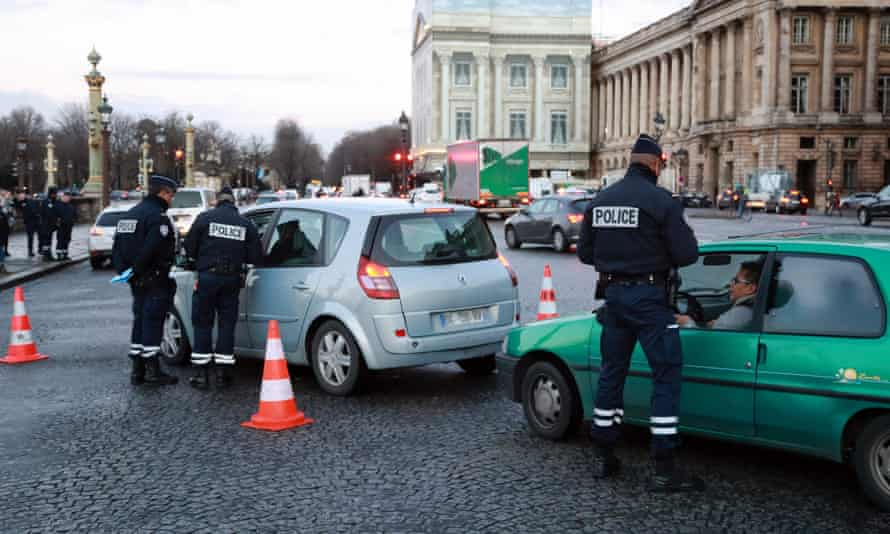 French police in Crit'Air sticker control operation on the Place de la Concorde in Paris.