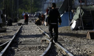 A child walks on the tracks in northern Greece