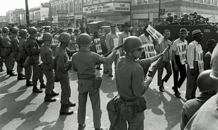 Memphis sanitation workers protest on 29 March 1968, watched by Tennessee National Guard troops with bayonets. Martin Luther King Jr was assassinated on 4 April while in Memphis supporting the strike.