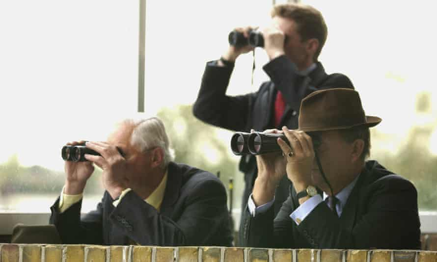 Race stewards follow the action at Windsor.