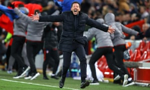 Diego Simeone, the Atlético Madrid manager celebrates his side's second goal at Anfield.