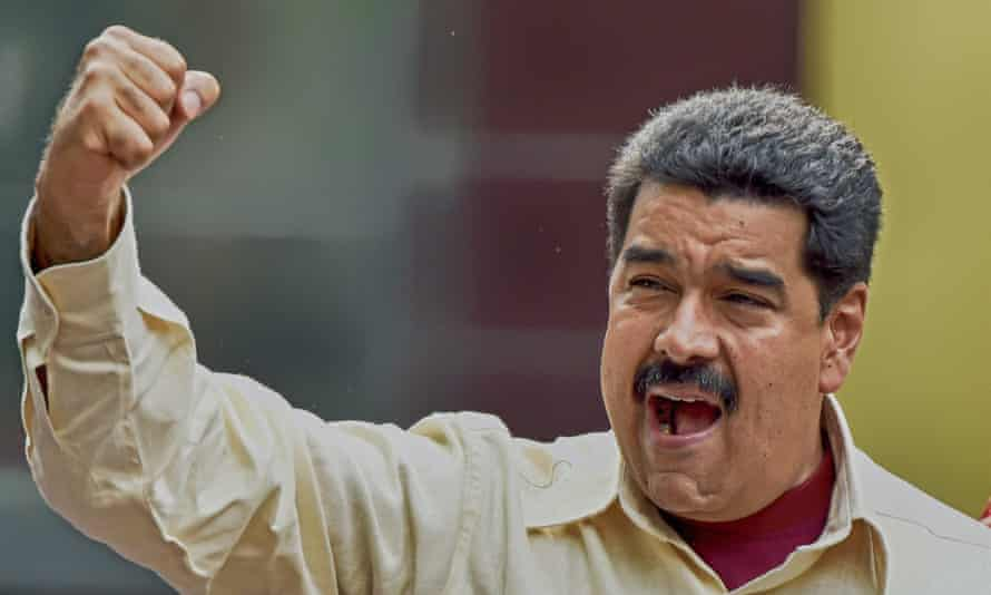 President Nicolas Maduro gestures to the crowd during a rally in Caracas.