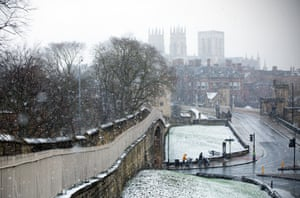 Snow falls in York. Most of England and Scotland are still covered by snow and ice warnings