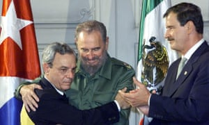 Fidel Castro embraces Spengler as Mexico's President Vicente Fox applauds.