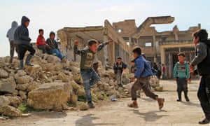 Children play in the village of Kufayr, in Syria's Idlib governorate