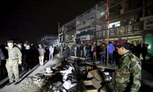 Wreckage from a car bomb outside a shopping mall in Baghdad on Monday. Seven people were killed in the bombing and another 11 died when gunmen entered the mall and opened fire on civilians.