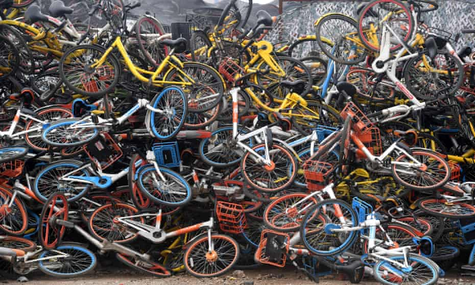 Bicycles of various bike-sharing services piled up in Wuhan, China, in 2018.