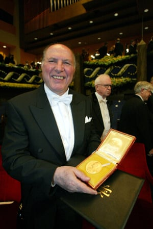 Kertész posing with his Nobel prize during the awards ceremony in Stockholm, 2002.