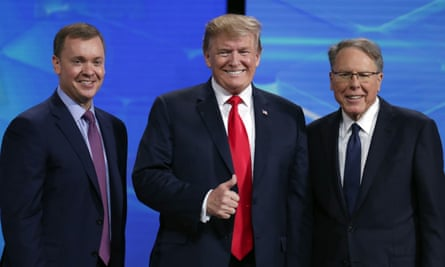Wayne LaPierre with Donald Trump and executive director Chris Cox. LaPierre was re-elected unopposed.