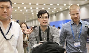Alek Sigley, who was detained in North Korea, arrives at Beijing international airport.