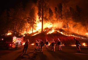 Firefighters try to control a backburn as the Carr wildfire spreads near Redding, California