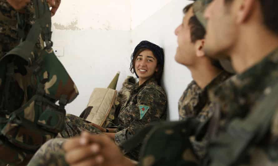 Fighters from the Kurdish People's Protection Units (YPG), part of the Syrian Democratic Forces (SDF), in the village of Fatisah in the northern Syrian province of Raqqa.