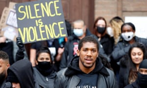 Boxer Anthony Joshua is seen with protesters during a Black Lives Matter protest in Watford.