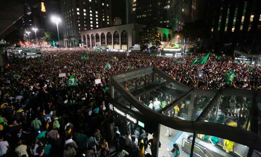 Demonstrators attend a protest at the appointment of Brazil's former president Luiz Inacio Lula da Silva as a minister, in Sao Paulo
