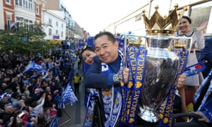 Vichai holding the Premier League trophy during the victory parade in 2016 to celebrate Leicester City FC's remarkable achievement.