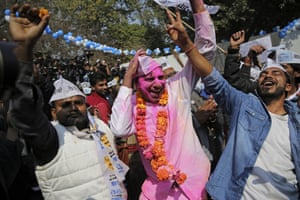 New Delhi, India Supporters of the Aam Aadmi party, celebrate victory at the polls at their party office in New Delhi