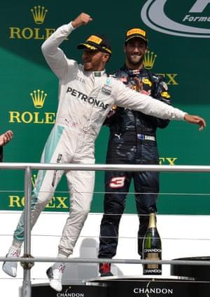 A celebratory leap from Lewis Hamilton on the podium.