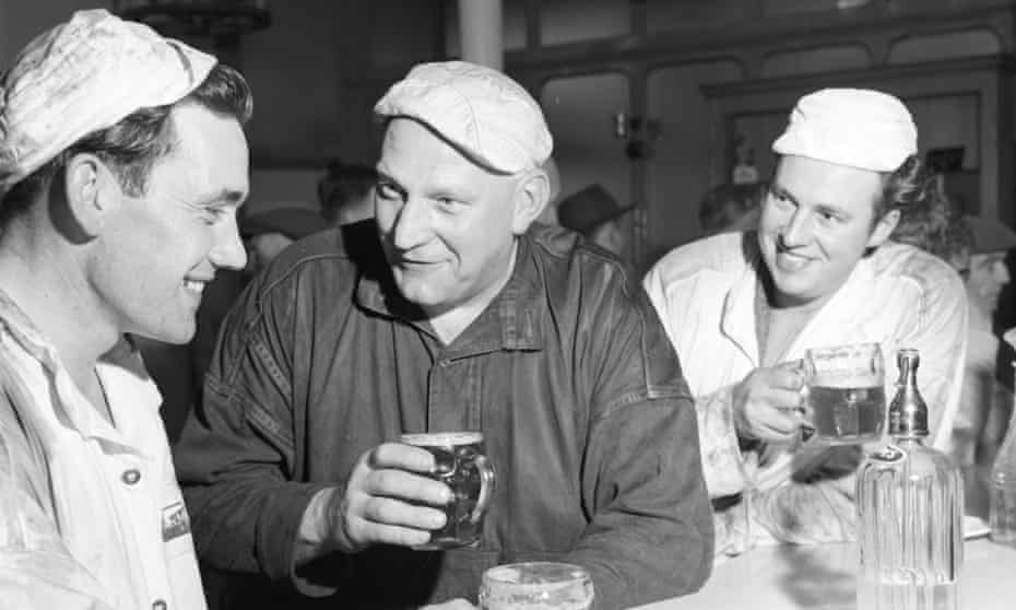 Porters at London's Smithfield Market enjoy an early morning after-work pint in 1961.