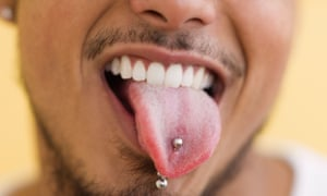 A man with a pierced tongue