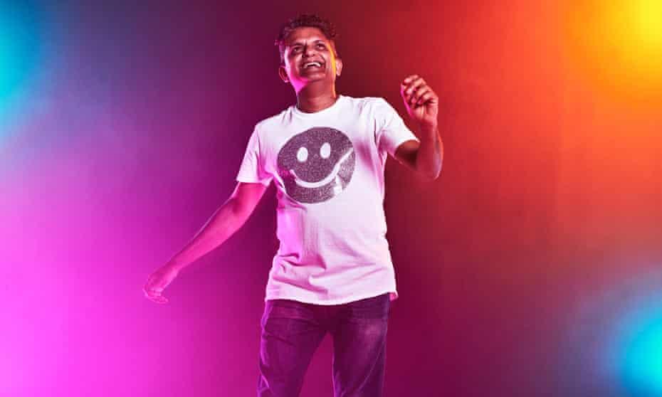 Clubber Suddi Raval dancing against multicoloured background