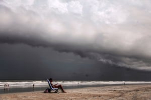 Tricia Cheshire, a resident of Amelia Island, sunbathes for the last few minutes before storms hit the coast ahead of Hurricane Dorian in Jacksonville.