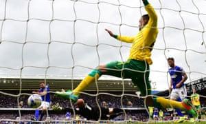 ipswich's Paul Anderson scores past Martin Olsson of Norwich.
