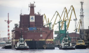 The Akademik Lomonosov is towed out of St Petersburg, Russia