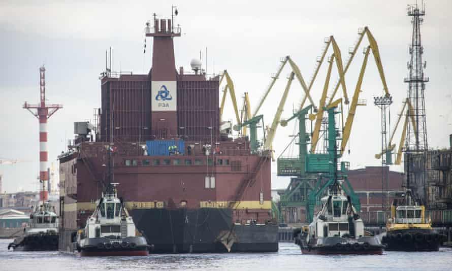 The Akademik Lomonosov is towed out of St Petersburg, Russia