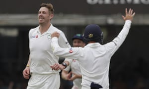 Ireland's Boyd Rankin, left, celebrates taking the wicket of England's Moeen Ali.