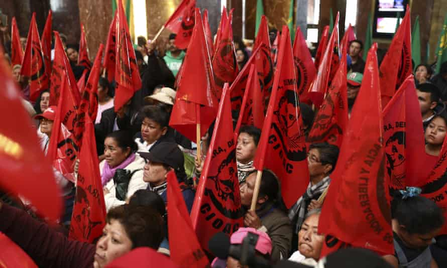 Farm workers block the entrance of the Fine Arts Palace to protest against the painting.