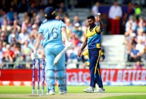 Sri Lanka's Isuru Udana (right) celebrates catching out England's Eoin Morgan.