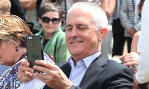 Malcolm Turnbull takes a photograph with his phone