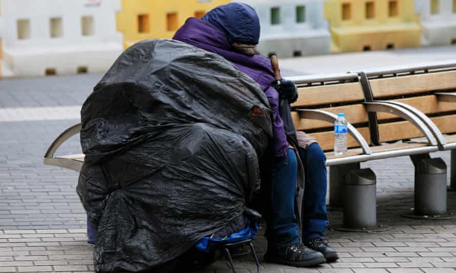 a homeless person on a bench