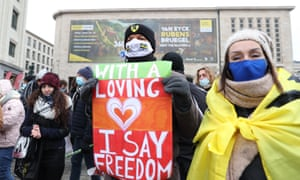 Protesters gather to stage a protest against government-imposed measures to tackle the coronavirus pandemic, at Albertine Square in Brussels, Belgium.