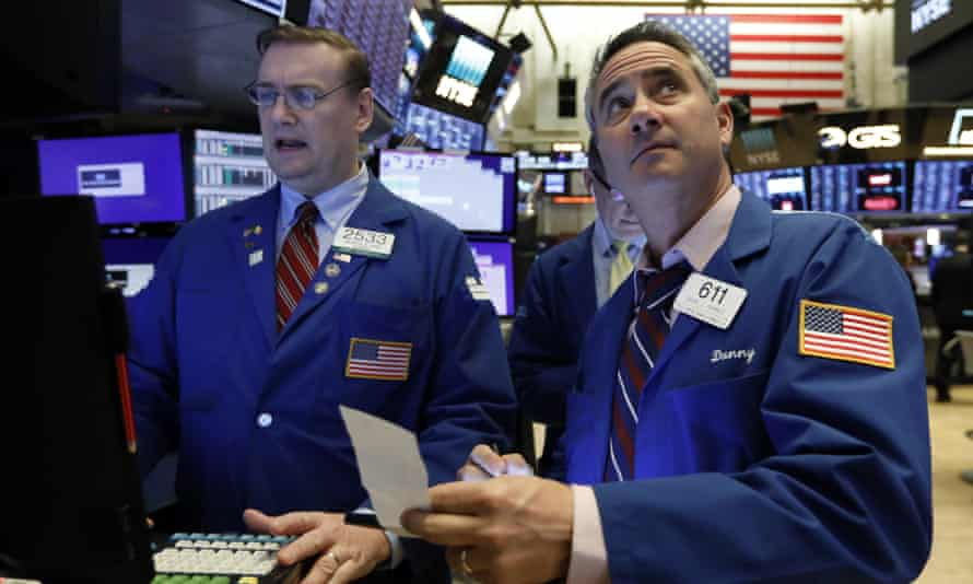 Two traders at the New York Stock Exchange