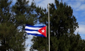 The Cuban flag flies at half mast in Havana on Saturday following Fidel Castro's death.