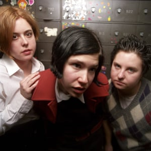 Corin Tucker, Carrie Brownstein and then-drummer Toni Gogin pose for a March 1996 portrait in Pennsylvania