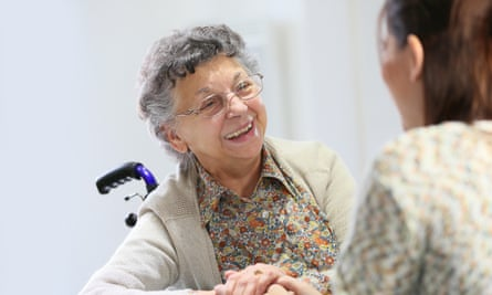 Elderly woman sharing good time with carer
