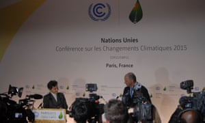 Christiana Figueres (left), executive secretary of the UN Framework Convention on Climate Change, and Laurent Fabius (right), president of the Paris climate talks and the French foreign minister.