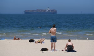Beachgoers at Port Melbourne beach in Victoria