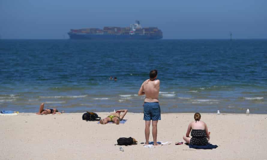 Beachgoers at Port Melbourne beach in Victoria