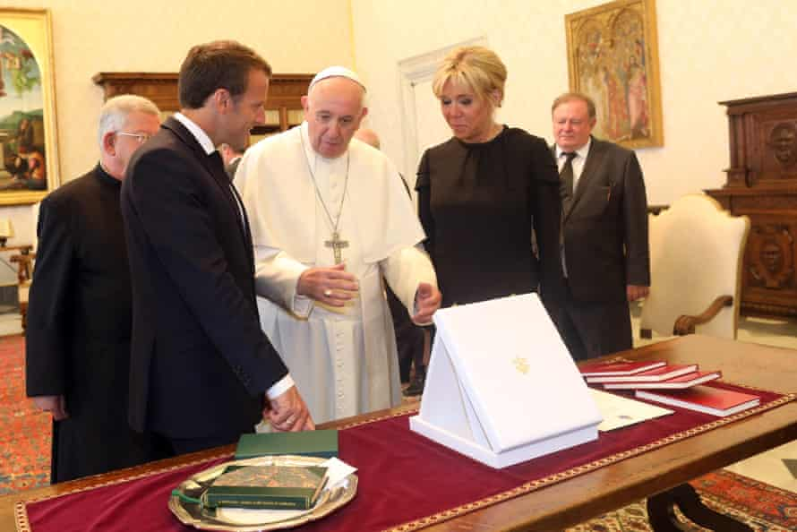 Pope Francis exchanges gifts with Emmanuel and Brigitte Macron in the Apostolic Palace.