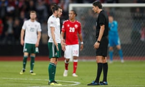 Gareth Bale protests with referee Deniz Aytekin after he awards a penalty to Denmark.
